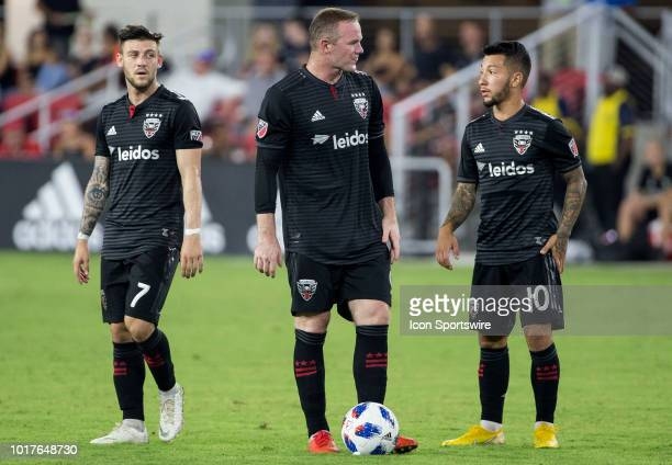 C United forward Wayne Rooney with forward Paul Arriola and midfielder Luciano Acosta before scoring off a free kick during a MLS match between DC...