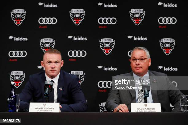 United General Manager Dave Kasper listens as Wayne Rooney of DC United speaks during his introduction press conference at The Newseum on July 2 2018...