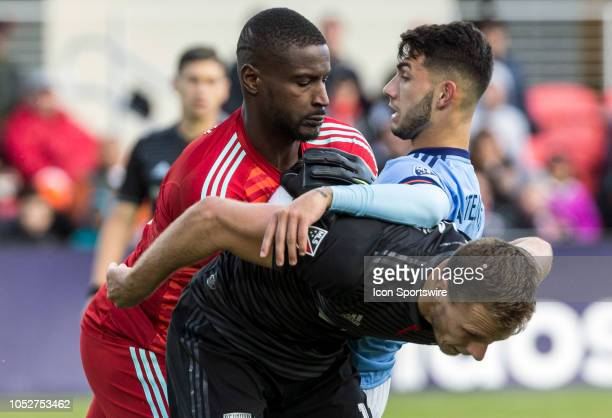 C United goalkeeper Bill Hamid and defender Frederic Brillant stop New York FC forward Valentin Castellanos during a MLS match between DC United and...