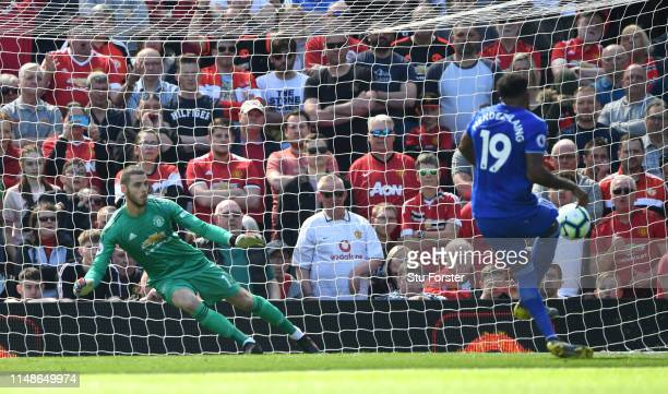 United goalkeeper David De Gea is sent the wrong way from the penalty spot by Cardiff player Nathaniel Mendez-Laing for the first Cardiff goal during...
