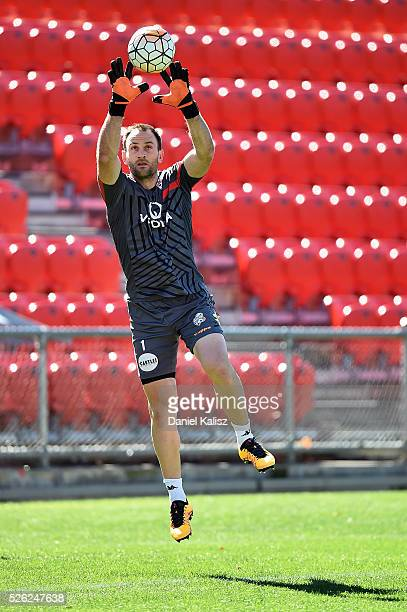 United goalkeeper Eugene Galekovic makes a save during an Adelaide United ALeague training session at Coopers Stadium on April 30 2016 in Adelaide...