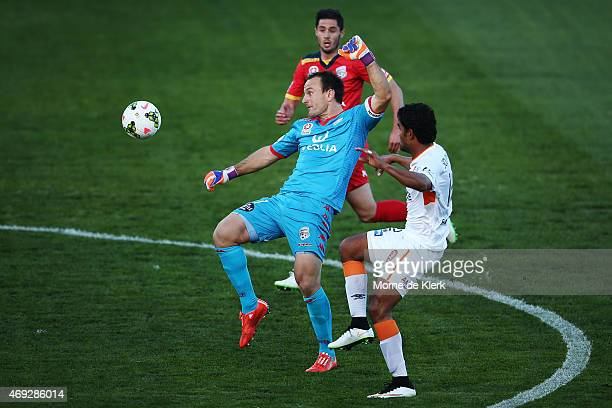 United goalkeeper Eugene Galekovic tries to save the ball after it bounced over his head during the round 25 ALeague match between Adelaide United...