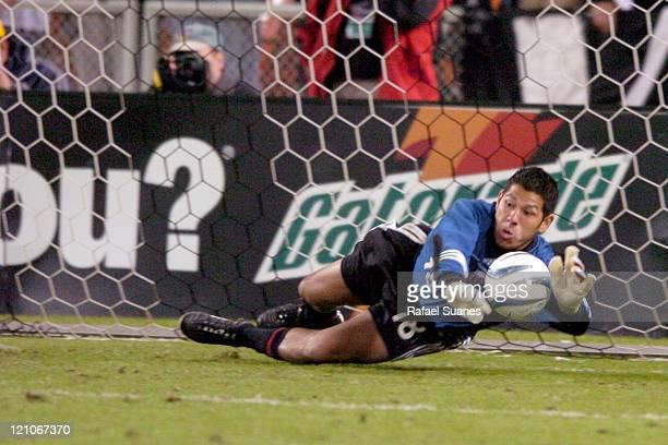 DC United goalkeeper Nick Rimando makes a save during penalty kicks at RFK Stadium in Washington DC Saturday November 6 2004 Regulation ended 33 DC...