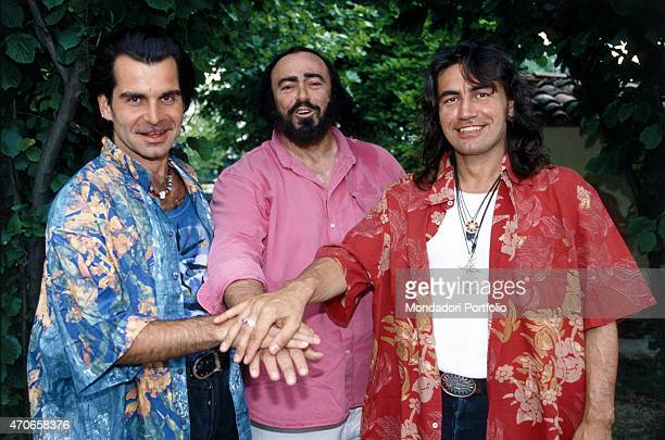 'United hands as a sign of agreement between the great tenor Luciano Pavarotti and two Italian rockers Piero Pel and Luciano Ligabue the three are...
