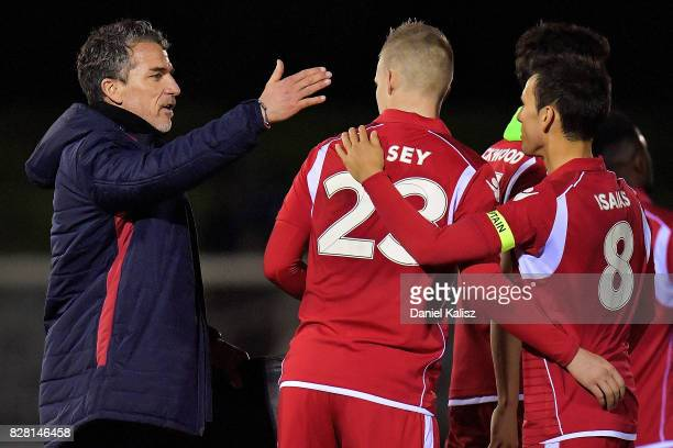 United head coach Marco Kurz congratulates Jordan Elsey of United during the round of 32 FFA Cup match between Adelaide United and the Newcastle Jets...