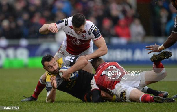 United Kingdom 13 January 2018 Alexis Balès of La Rochelle is tackled by Louis Ludik and Jacob Stockdale of Ulster during the European Rugby...