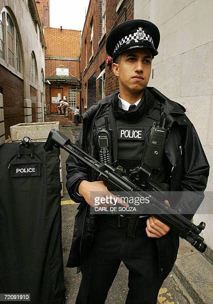 A British armed policeman stands guard outside a side entrance to the Israeli Consulate in London 05 October 2006 Britain's top policeman ordered an...