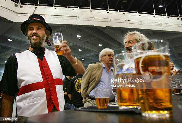 United Kingdom: A drinker sporting a St. George waistcoat enjoys his beer during the opening day of The Great British Beer Festival in Earl's Court...