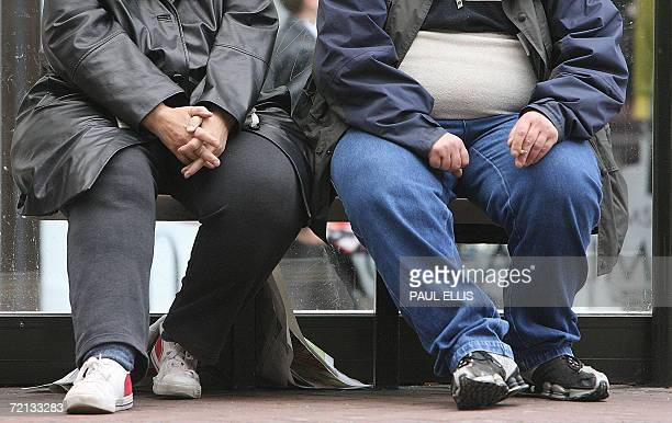 United Kingdom: A man and a woman wait at a tram stop in Manchester, in north-west England, 10 October 2006. The United Kingdom is the fattest...