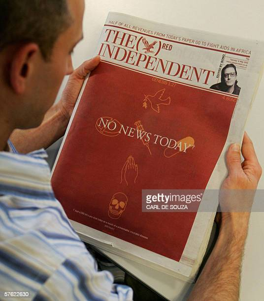 A man reads a copy of Tuesday 16 May 2006 edition of the Independent newspaper in London Irish rock star Bono added journalism to his CV on Tuesday...