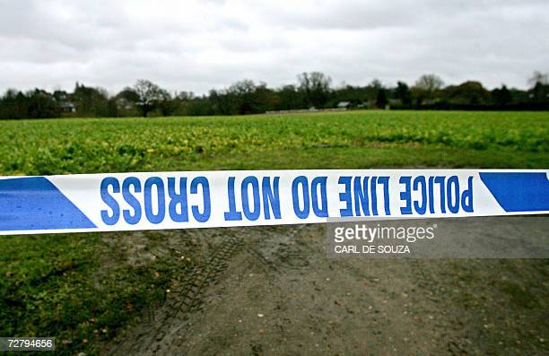A police cordon surrounds a crime scene in Nacton in Suffolk in southeast England 11 December 2006 after the body of a third prostitute was...