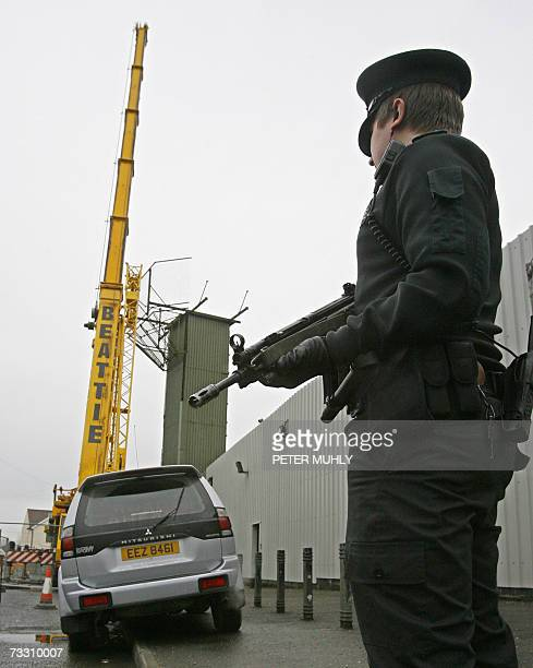 A PSNI monitors the removal of parts of the Crossmaglen watchtower i13 a former British army watchtower in Crossmaglen in Northern Ireland 13...