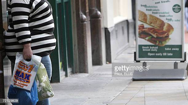 United Kingdom: A woman stands outside a sandwich shop in Manchester, in north-west England, 10 October 2006. The United Kingdom is the fattest...