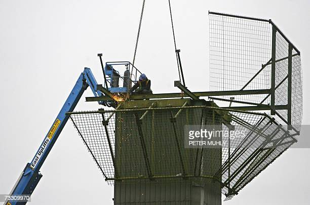 A workman cuts away metal from the top of the Crossmaglen watchtower a former British Army watchtower in Crossmaglen in Northern Ireland 13 February...