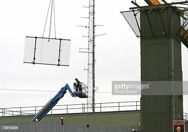 A workman monitors the removal of parts of the Crossmaglen watchtower i13 a former British army watchtower in Crossmaglen in Northern Ireland 13...