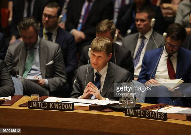 United Kingdom Ambassador to the United Nations Jonathan Allen listens to the Russian ambassador speak in the security council after the UK called...