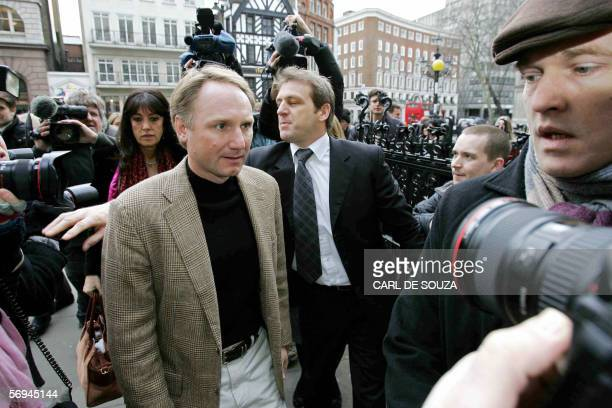 American author of the best selling book 'The Da Vinci Code' Dan Brown arrives at the High Court in London 27 February 2006 Authors Richard Leigh and...