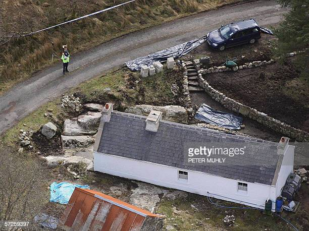 An aerial image taken 05 April 2006 shows Garda police guarding the house of former IRA spy Denis Donaldson in Donegal in Ireland Irish police...