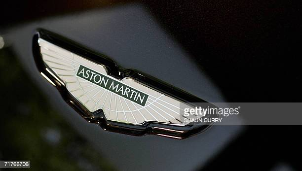 An Aston Martin badge is photographed on a vehicle in a showroom in London 01 September 2006 US auto giant Ford announced Thursday it wants to hive...