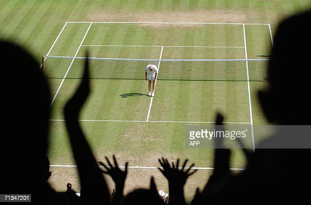 Andre Agassi of the United States waves to the crowd at Wimbledon for the last time after losing his match to Spain's Rafel Nadal on the sixth day of...