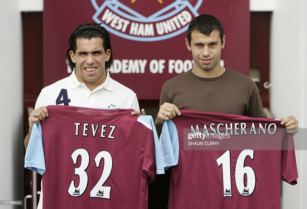Argentinian footballer's Carlos Tevez (L) and Javier Mascherano pose with their new West Ham United Club shirts at a photocall at Upton Park, in east London, 05 September 2006. Striker Tevez and midfielder Mascherano, both aged 22, featured for Argentina at the World Cup finals and their move to Upton Park came on the final day of the transfer window.