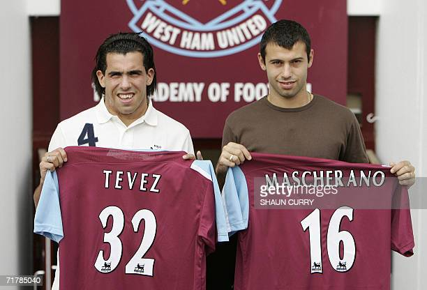 Argentinian footballer's Carlos Tevez and Javier Mascherano pose with their new West Ham United Club shirts at a photocall at Upton Park in east...