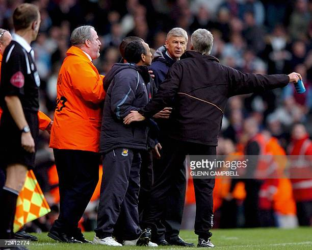 Arsenal manager Arsene Wenger exchanges words with West Ham manager Alan Pardew as West Ham defeat Arsenal 10 in the English Premier League match at...