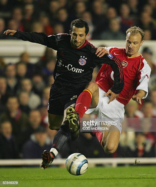 Arsenal's captain Dennis Bergkamp tackles Bayern Munich's Hasan Salihamidzic during their second leg Champion's League football match at Highbury in...