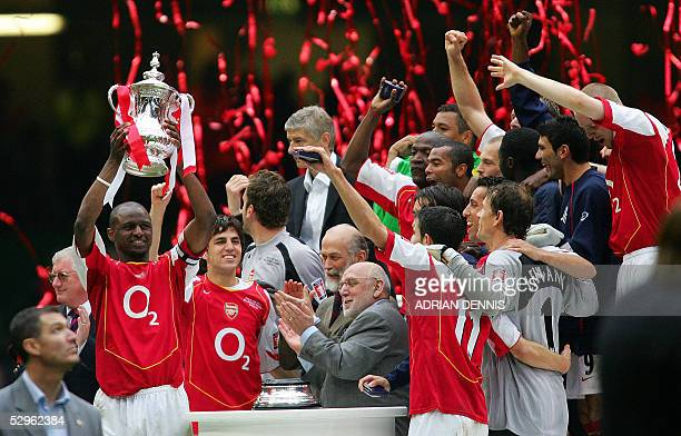 Arsenal's Patrick Vieira lifts the FA Cup as he celebrates with his teammates winning the FA Cup Final football match against Manchester United at...