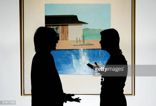 Art enthusiasts enjoy a painting by British artist David Hockney entitled 'Splash' at Sotheby's auction house in London 18 May 2006 The painting one...