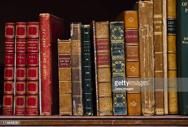 United Kingdom, Bristol, close up of antique books on shelf