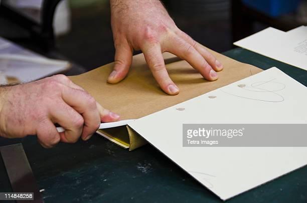 United Kingdom, Bristol, close up of hands of book binder