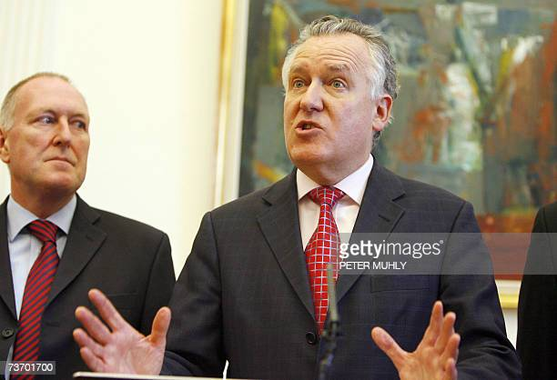 United Kingdom: Britain's Northern Ireland Secretary Peter Hain speaks with the media beside Paul Goggins at Stormont Castle in Belfast, Northern...
