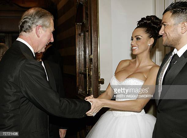 Britain's Prince Charles meets glamour model Katie Price also known as 'Jordan' and her husband Peter Andre at The Royal Variety performance in...