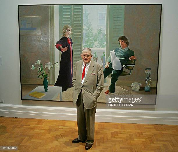 British artist David Hockney poses in front of his painting entitled 'Mr and Mrs Clark and Percy' at the National Portrait Gallery in London 11...