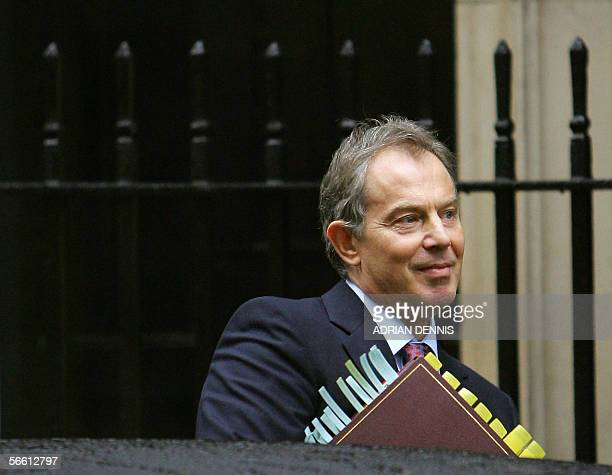 British Prime Minister Tony Blair gets into a car outside No10 Downing Street in London 18 January 2006 as he leaves for the House of Commons for the...