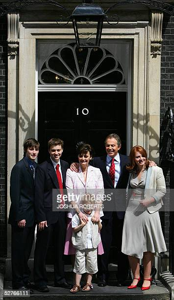 British Prime Minister Tony Blair stands on the step of No 10 Downing Street with his sons Nicky Euan and Leo wife Cherie and daughter Kathryn in...