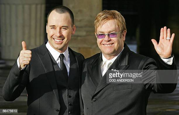 British singer Sir Elton John and his partner David Furnish pose for photographs at the Guildhall in Windsor 21 December 2005 after conducting a...