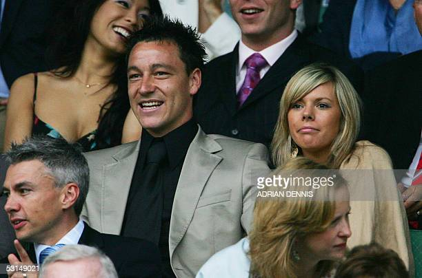 Chelsea football player John Terry and Toni Poole sit in the Royal Box on Centre Court at the 119th Wimbledon Tennis Championships in London 25 June...