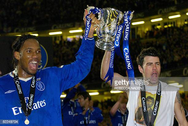 Chelsea's Didier Drogba and Mateja Kezman hold up the Carling Cup trophy with his teammates after defeating Liverpool in the Carling Cup Final...