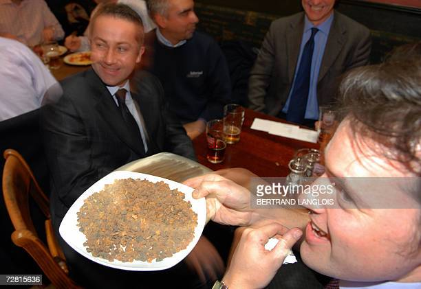 Christmas drinkers and diners try to identify a plate of myrrh during a challenge organised by members of the British Royal Society of Chemistry in a...