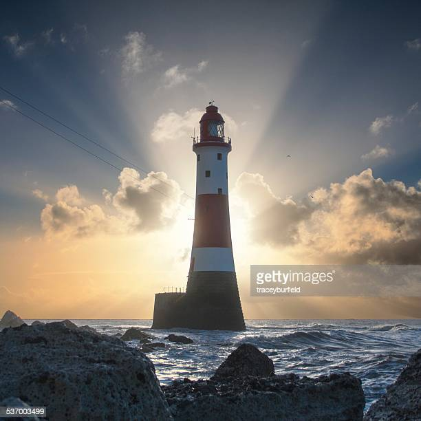 United Kingdom, England, East Sussex, Beachy Head, Beachy Head Lighthouse backlit by rising sun