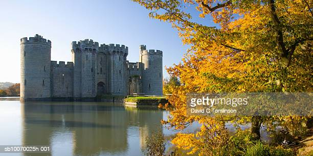 united kingdom, england, east sussex, bodiam castle and moat with autumn tree - 2007 stock pictures, royalty-free photos & images