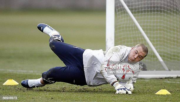England football goalkeeper Paul Robinson makes a save during a training session at Liverpool's Melwood training ground in northwest England 27...