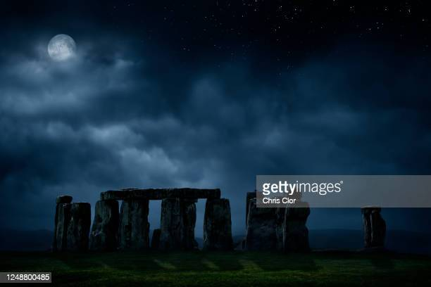 united kingdom, england, full moon above stonehenge - rock stock pictures, royalty-free photos & images