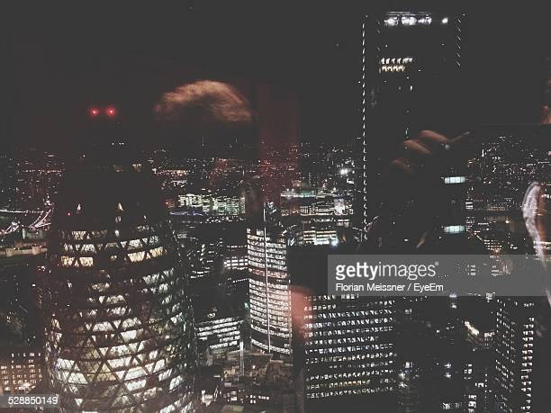 United Kingdom, England, London, Elevated View Of Illuminated Cityscape With The Gherkin And Nearby Skyscrapers