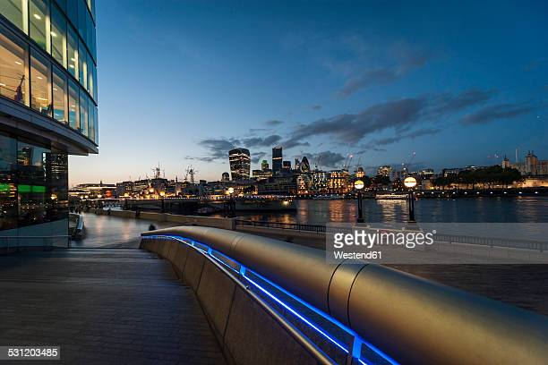 United Kingdom, England, London, River Thames, View to high-rise buildings, Swiss Re Tower, Tower 42, 20 Fenchurch Street and Tower of London in the evening