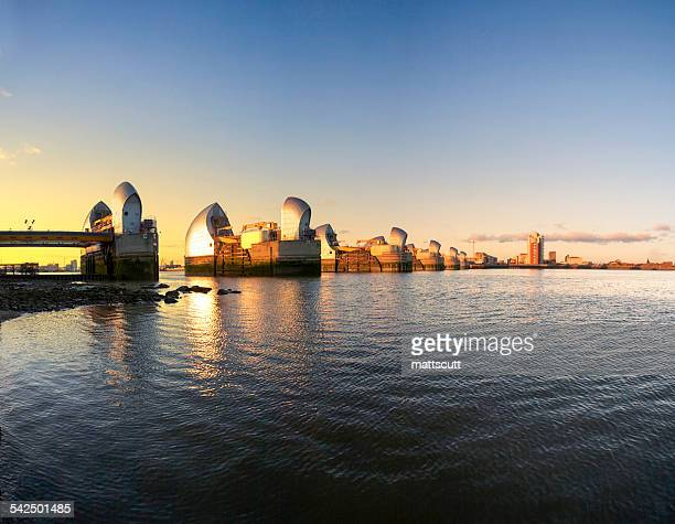 united kingdom, england, london, thames barrier towers at sunset - mattscutt stock pictures, royalty-free photos & images