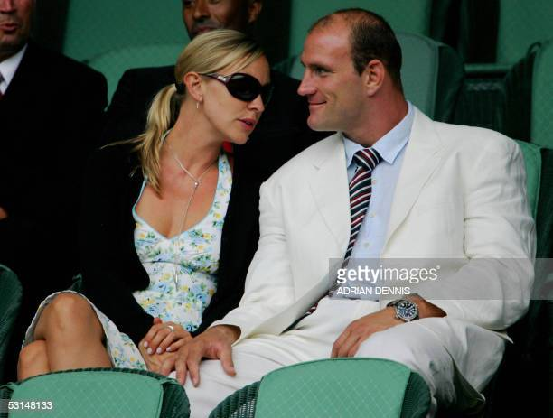 England rugby player Lawrence Dallaglio and Alice Corbett watch Nicolas Kiefer of Germany and Roger Federer of Switzerland play from the Royal box...