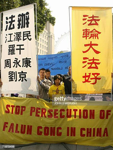 Falun Gong protestors gather outside 10 Downing Street in London 13 September 2006 where British Prime Minister Tony Blair is meeting with his...